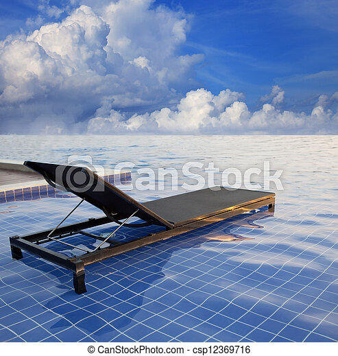 pool bed and blue sky white cloud - csp12369716