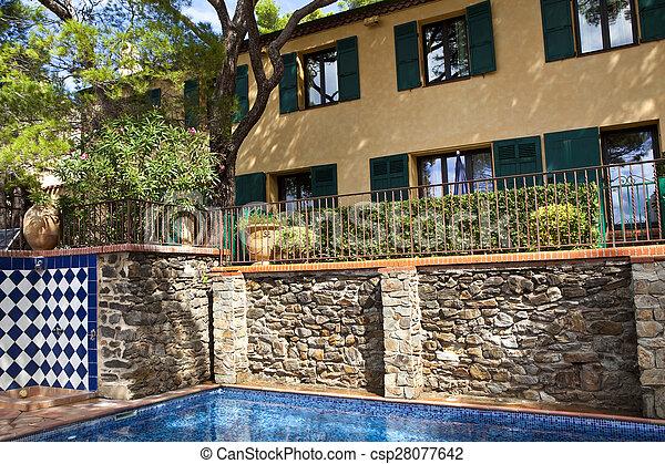 Pool in a garden - csp28077642
