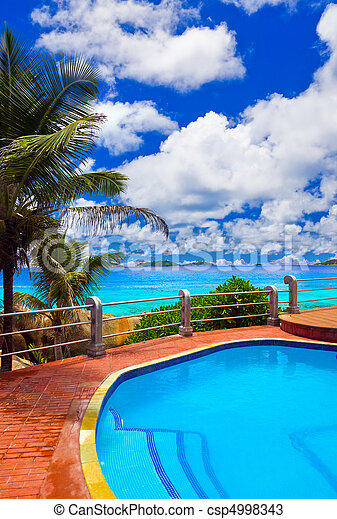 Pool in hotel at tropical beach - csp4998343