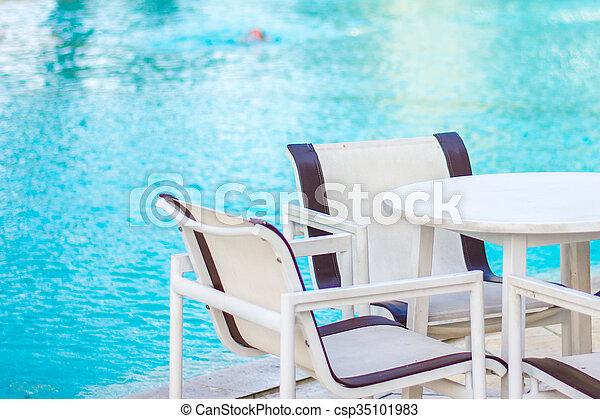 Poolside Table U0026 Chairs Stock Photo