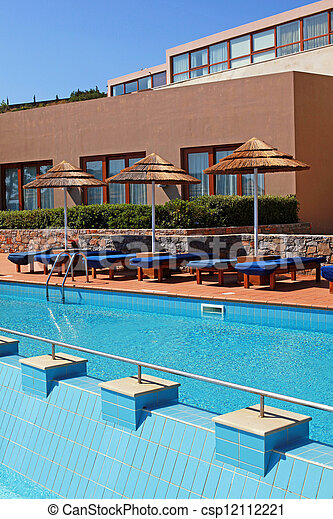 poolside with pool bed and umbrella in luxury resort - csp12112221