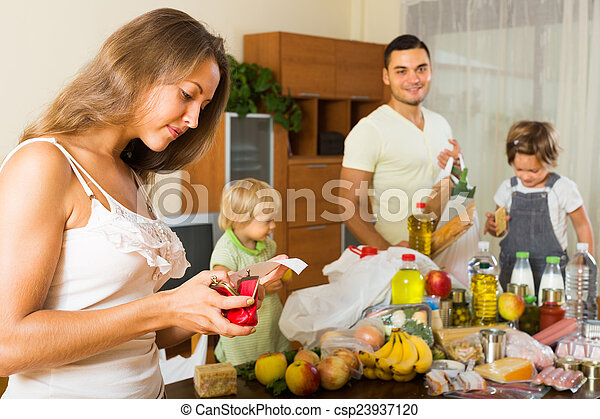 Poor family with bags of food - csp23937120