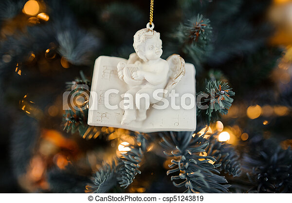 Porcelain Christmas tree decoration toy in the form of cute little angel - csp51243819