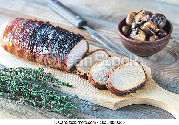 Pork loin wrapped in bacon with roasted mushrooms - csp53830085