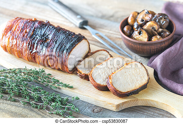 Pork loin wrapped in bacon with roasted mushrooms - csp53830087
