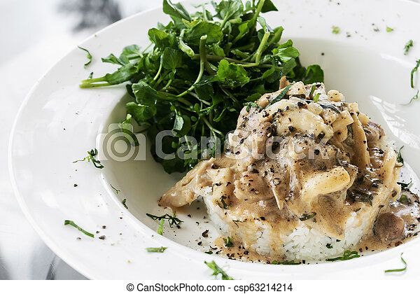 Pork Stroganoff with mushroom cream and paprika sauce gourmet meal - csp63214214