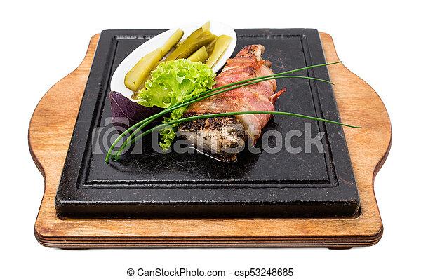Pork tenderloin stuffed with herbs and garlic. - csp53248685