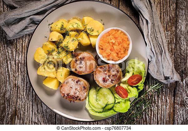 Pork tenderloin wrapped in bacon. - csp76807734