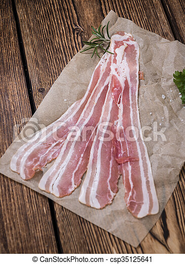 Portion of raw Bacon - csp35125641