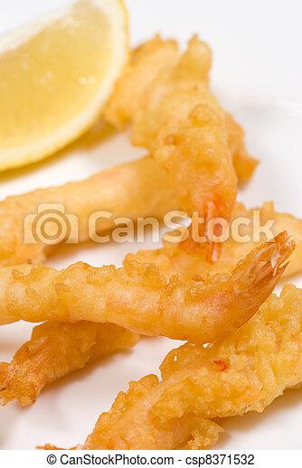Portion of tempura prawns - csp8371532