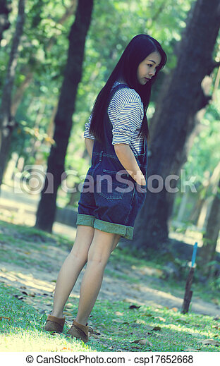 Portrait Beautiful asian woman in Park - csp17652668