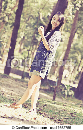 Portrait Beautiful asian woman in Park - csp17652755