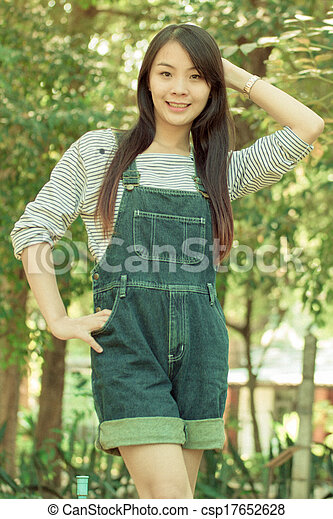 Portrait Beautiful asian woman in Park - csp17652628