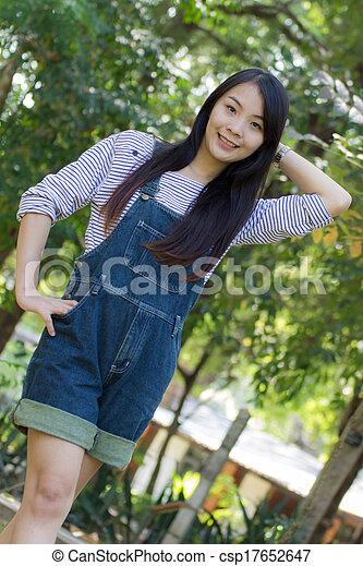 Portrait Beautiful asian woman in Park - csp17652647