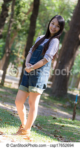 Portrait Beautiful asian woman in Park - csp17652694