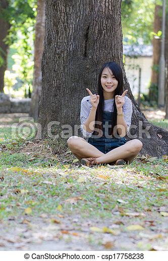 Portrait Beautiful asian woman in Park - csp17758238