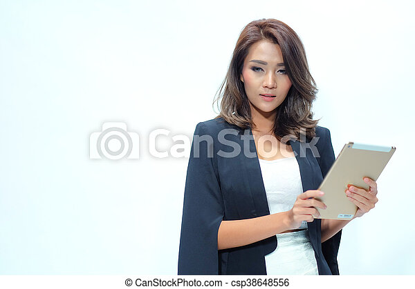 Portrait beautiful asian woman standing, Hold tablet - csp38648556