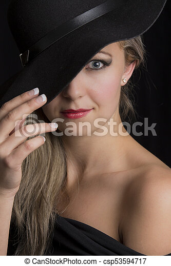 Portrait close-up of a beautiful blond woman with black hat - csp53594717
