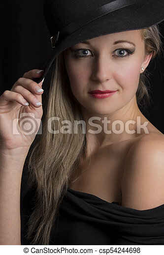 Portrait close-up of a beautiful blond woman with black hat - csp54244698