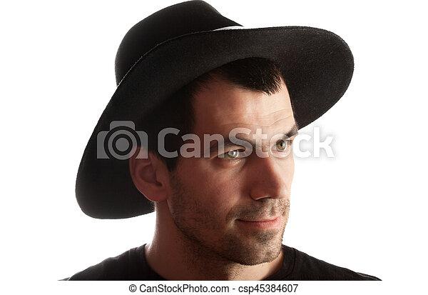 d1d054bd86f69 Portrait, homme, chapeau noir. Isolé, arrière-plan noir, portrait ...