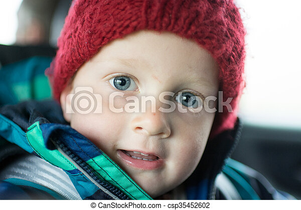 Portrait of a 3 year old boy in winter - csp35452602