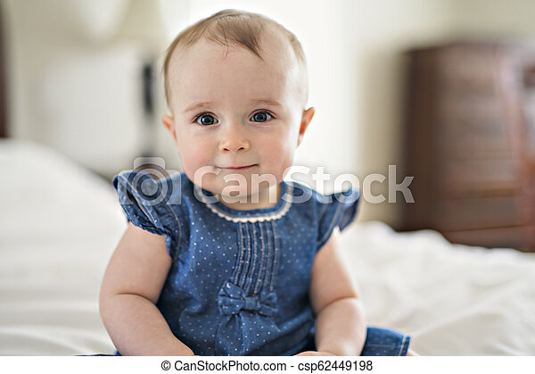 Portrait of a baby on the bed - csp62449198