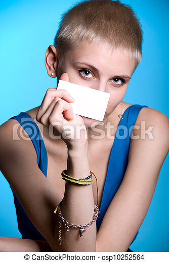 Portrait of a beautiful girl holding a blank notecard. - csp10252564