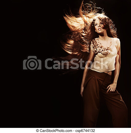 Portrait of a beautiful girl with flying long hair - csp6744132