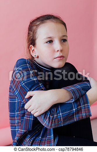 portrait of a beautiful schoolgirl girl on a pink background - csp78794846