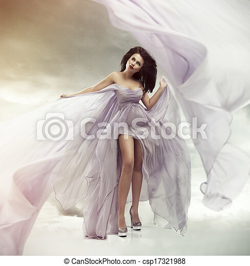 Portrait of a beautiful sexy young woman in violet dress - csp17321988