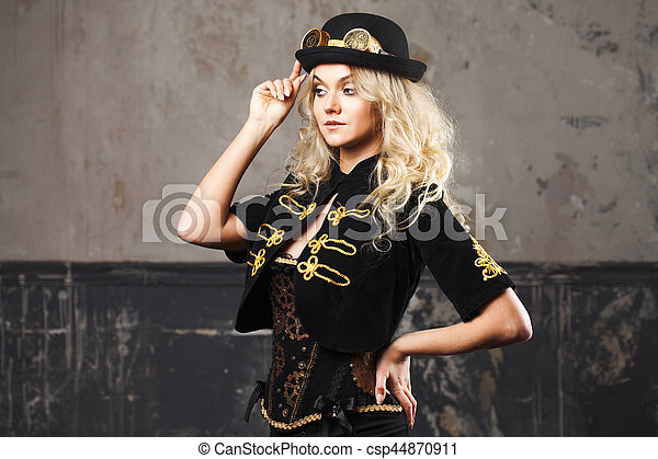 a10826371bc Portrait of a beautiful steampunk woman hat-bowler hat over grunge  background. - csp44870911