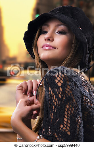 portrait of a beautiful woman at sunset in the city - csp5999440