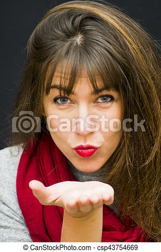 Portrait of a beautiful woman Giving a kiss to the air - csp43754669