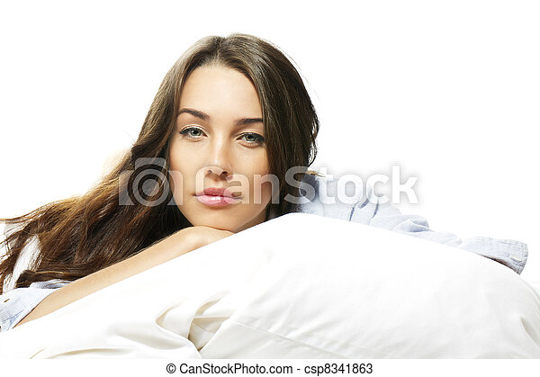portrait of a beautiful woman in bed on white background - csp8341863