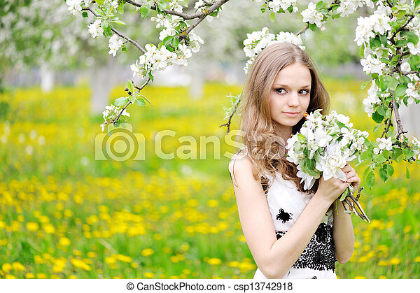 portrait of a beautiful woman in spring - csp13742918