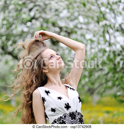 portrait of a beautiful woman in spring - csp13742908