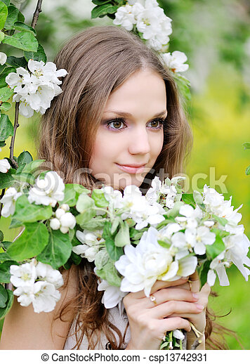 portrait of a beautiful woman in spring - csp13742931