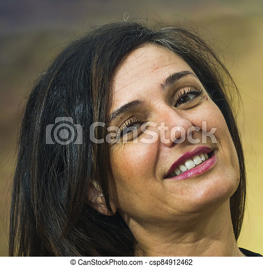 Portrait of a beautiful woman on white background - csp84912462