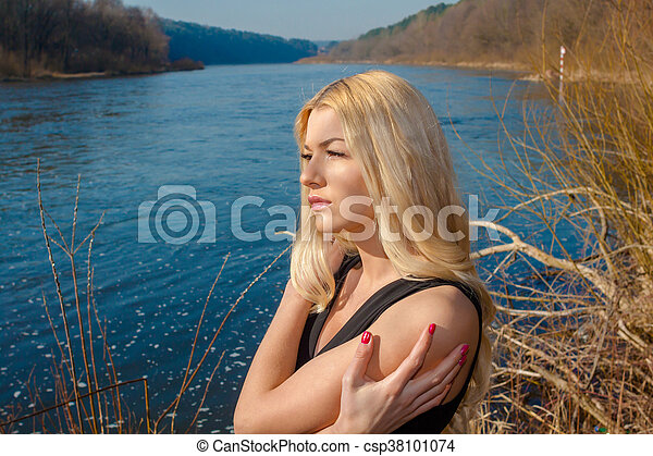 portrait of a beautiful woman outdoors in spring - csp38101074