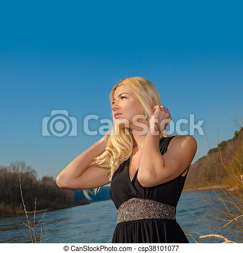 portrait of a beautiful woman outdoors in spring - csp38101077