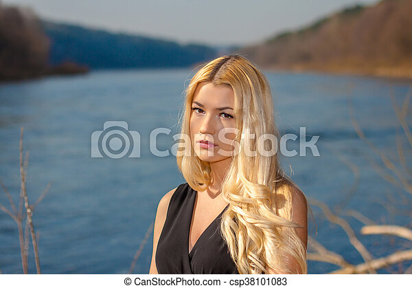 portrait of a beautiful woman outdoors in spring - csp38101083
