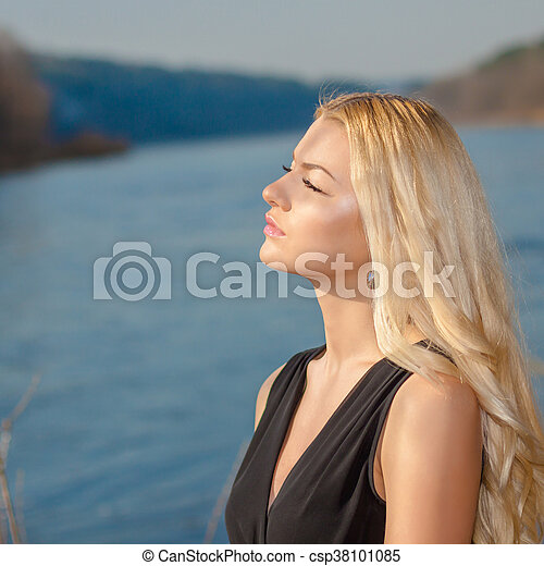 portrait of a beautiful woman outdoors in spring - csp38101085