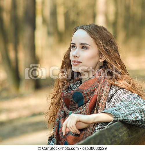 portrait of a beautiful woman outdoors in spring - csp38088229