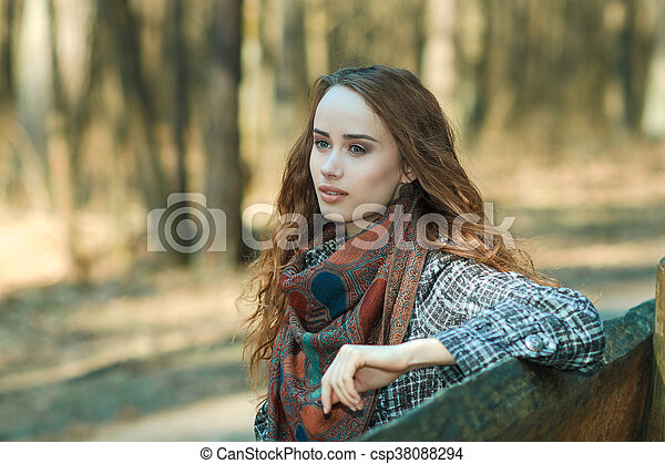 portrait of a beautiful woman outdoors in spring - csp38088294