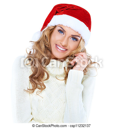 Portrait of a beautiful woman wearing a santa hat - csp11232137