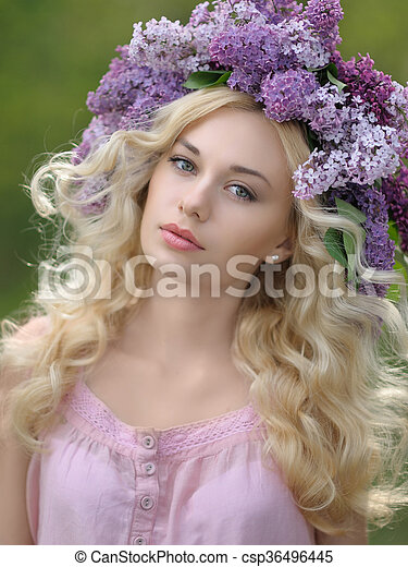 portrait of a beautiful woman with flowers in the summer - csp36496445