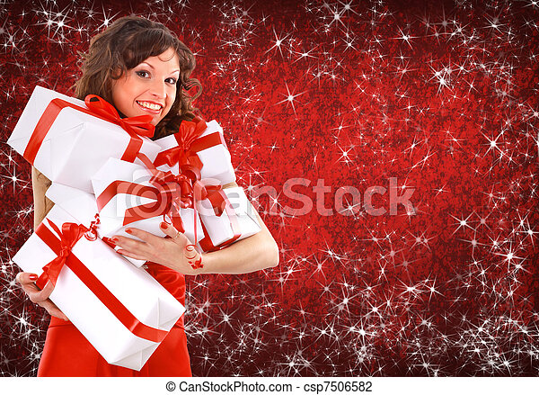 Portrait of a beautiful young woman wearing christmas clothes over sky of stars and snow.  - csp7506582