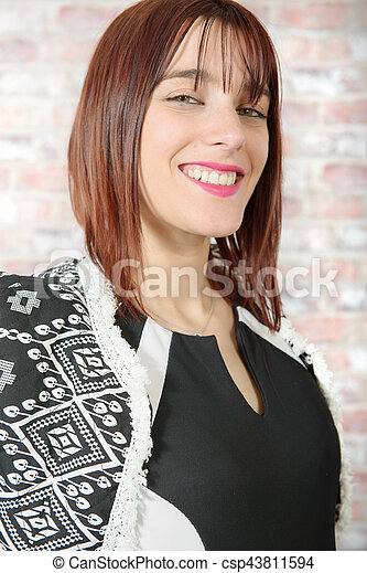 Portrait of a beautiful young woman - csp43811594