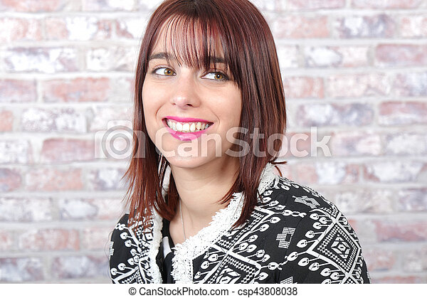 Portrait of a beautiful young woman - csp43808038