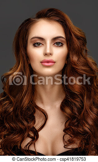 Portrait of a beautiful young woman with elegant long red shiny hair - csp41819753
